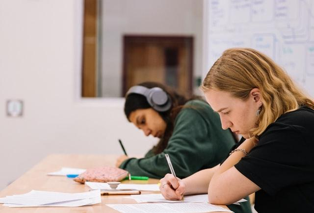 Two students working on assignments